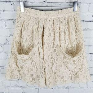 KIMCHI BLUE   lace back zip pocket skirt